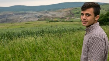 Armend Grajcevci, 15, stands at the edge of Hade, his village in central Kosovo