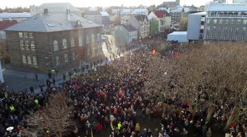 Protesters outside the parliament building in Reykjavik, Iceland on Monday