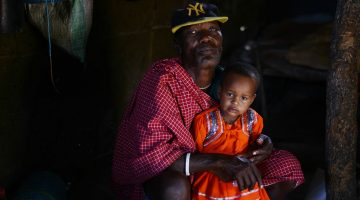 Facing eviction: Barabaig elder Salumu Kundaya Kidomwita, 60, with his two-year-old daughter Mama