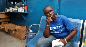 Bimbo Omowole Osobe, a former resident of the Badia East slum who was evicted in 2013 when her neighborhood was demolished, sits in the clinic where she now sleeps at night in the reception area