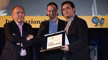 Carlos Dada (right) receives the 2012 Anna Politkovskaya Award