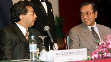 Then-Malaysian Prime Minister Mahathir Mohamad (right) with his son Mirzan Mahathir at the 1997 ASEAN summit