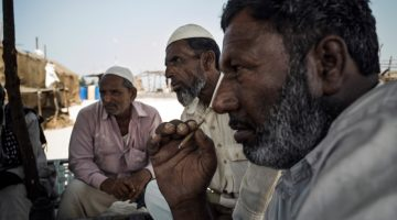 Yunus Suleman Gadh and other fisherfolk discuss how the Tata plant has harmed both their livelihoods and their health