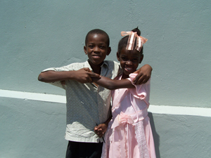 Two young members of the Redemption Church congregation play outside church after Sunday services