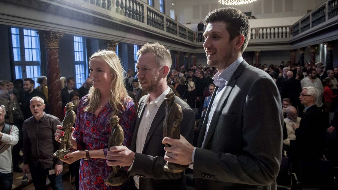 Eva Jung, Simon Bendtsen and Michael Lund accept the Cavling Prize