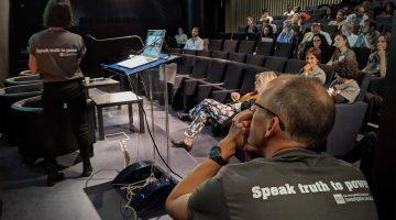 """ICIJ team in """"Speak truth to power"""" t-shirts"""